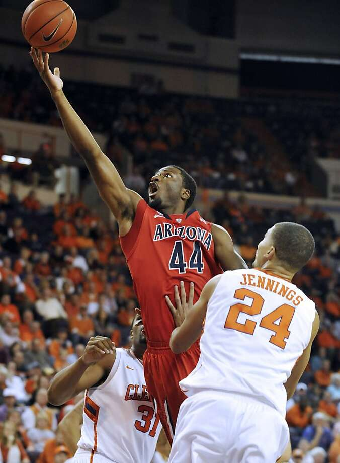 Arizona's Solomon Hill shoots over Clemson's Milton Jennings (right) in the first half. Photo: Rainier Ehrhardt, Associated Press