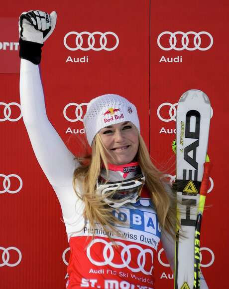 US Lindsey Vonn celebrates on the podium after the women's Alpine skiing World Cup super-G on December 8, 2012 in St. Moritz. Lindsey Vonn of the US won the race ahead of Slovenia's Tina Maze and fellow American Julia Mancuso. AFP PHOTO / FABRICE COFFRINIFABRICE COFFRINI/AFP/Getty Images Photo: FABRICE COFFRINI, Staff / AFP