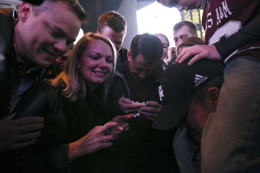 Texas A&M fans wait for the Heisman Trophy announcement in Times Square Saturday Dec. 8, 2012 in New