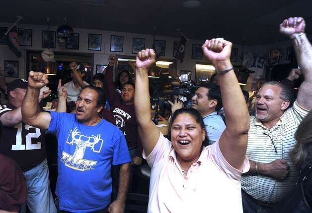 Fans of Texas A&M quarterback Johnny Manziel gather at the Wing King restaurant in Kerrville, Texas, for the televised Heisman Trophy announcement on Saturday night, Dec. 8, 2012. Manziel played high school football for Tivy High School in Kerrville.