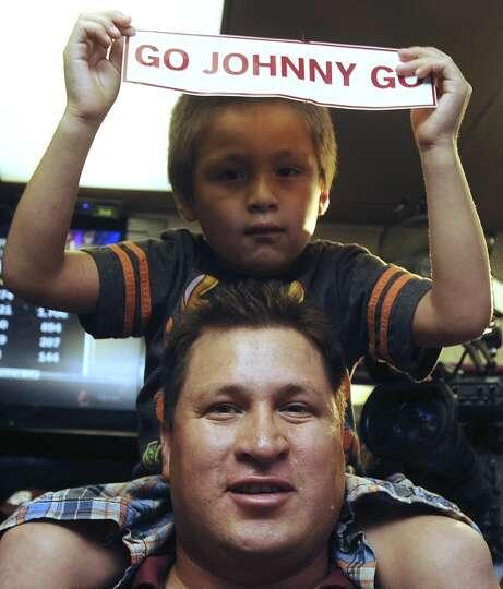 Tony Castillo and son, Jaden, show their enthusiasm for Johnny Manziel, Texas A&M quarterback who wo