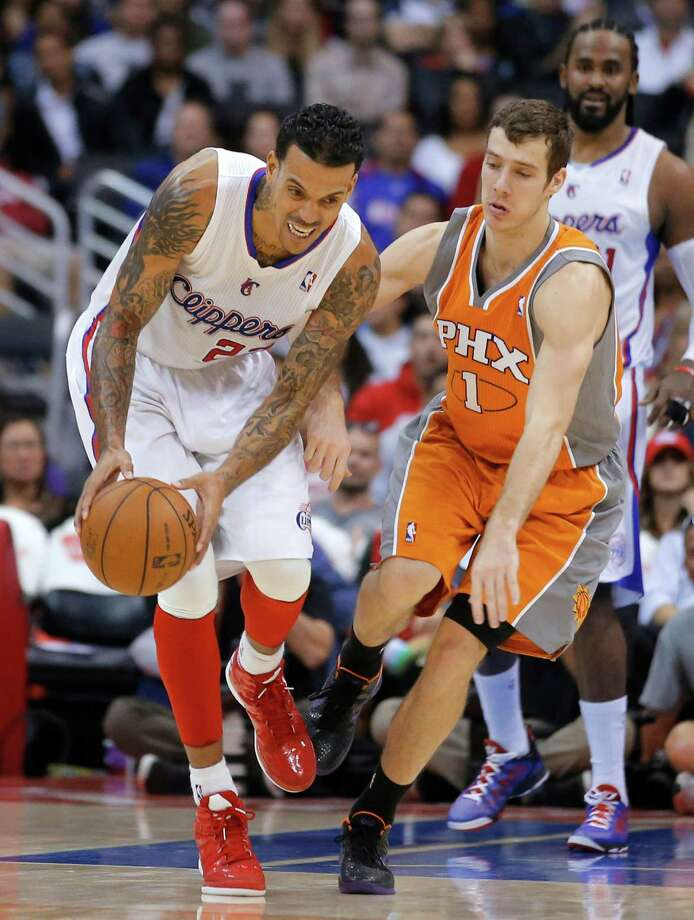 Los Angeles Clippers' Matt Barnes, left, moves with the ball next to Phoenix Suns' Goran Dragic, of Slovenia, in the second half of an NBA basketball game in Los Angeles, Saturday, Dec. 8, 2012. The Clippers won 117-99. (AP Photo/Jae C. Hong) Photo: Jae C. Hong