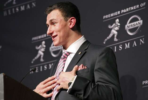 Texas A&M's quarterback Johnny Manziel, the 2012 Heisman Trophy winner, answers questions from the media during a press conference Saturday Dec. 8, 2012 at the New York Marriott Marquis hotel in New York, New York.
