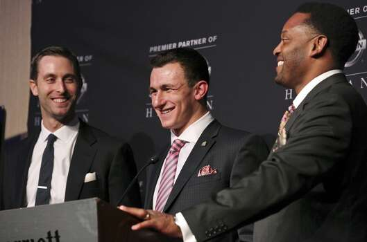 Texas A&M's offensive coordinator and quarterbacks coach Kliff Kingsbury (from left), Texas A&M's quarterback Johnny Manziel, the 2012 Heisman Trophy winner, and Texas A&M's headcoach Kevin Sumlin answer questions from the media during a press conference Saturday Dec. 8, 2012 at the New York Marriott Marquis hotel in New York, New York. (Edward A. Ornelas / San Antonio Express-News)