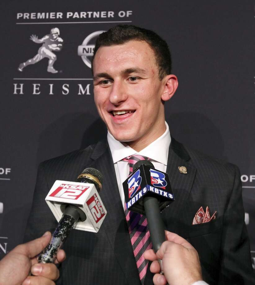 Texas A&M's quarterback Johnny Manziel, the 2012 Heisman Trophy winner, answers questions from the media Saturday Dec. 8, 2012 at the New York Marriott Marquis hotel in New York, New York.