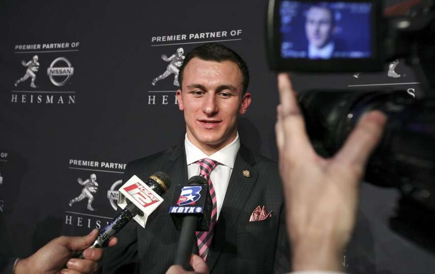 Texas A&M's quarterback Johnny Manziel, the 2012 Heisman Trophy winner, answers questions from the m