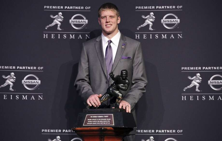 Heisman finalist Kansas State's quarterback Collin Klein poses for photos during a press conference before the Heisman winner announcement Saturday Dec. 8, 2012 at the New York Marriott Marquis hotel in New York, New York.