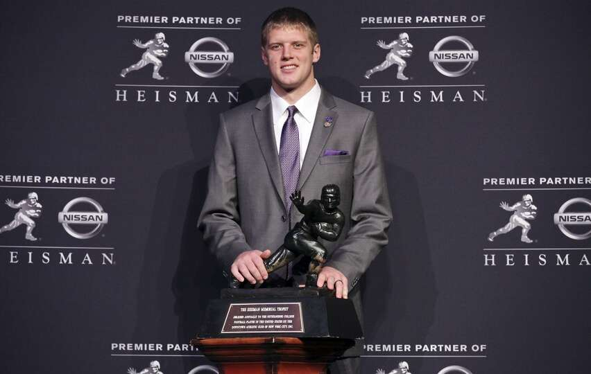 Heisman finalist Kansas State's quarterback Collin Klein poses for photos during a press conference