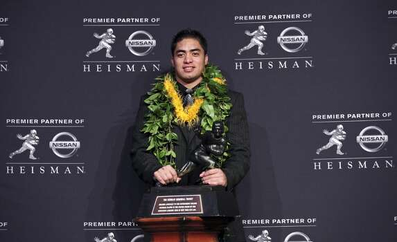 Heisman finalist Notre Dame's linebacker Manti Te'o poses for photos during a press conference before the Heisman winner announcement Saturday Dec. 8, 2012 at the New York Marriott Marquis hotel in New York, New York.
