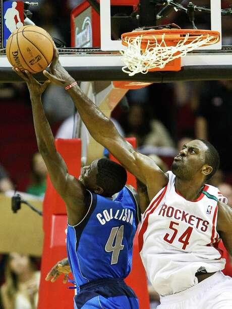 Mavericks guard Darren Collison (4) has his shot blocked by Rockets forward Patrick Patterson. Photo: Nick De La Torre, Staff / © 2012  Houston Chronicle