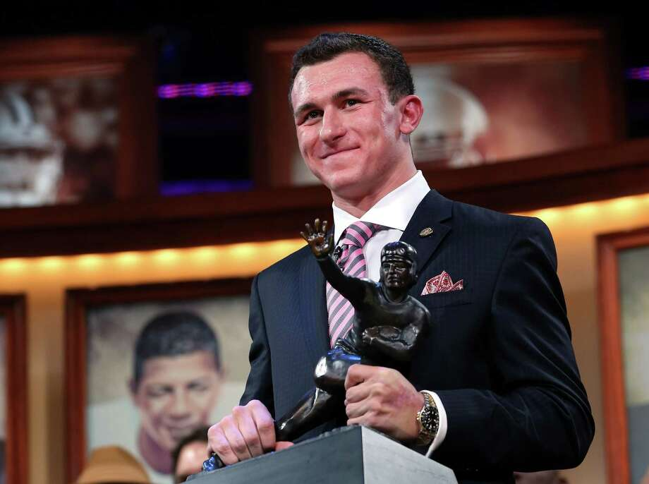Texas A&M quarterback Johnny Manziel has a firm grip on the Heisman Trophy, both figuratively and literally, on Saturday night in New York. The redshirt freshman outpolled runner-up Manti Te'o in five of six regions as well as in total points 2,029 to 1,706. Photo: Handout / 2012 Kelly Kline