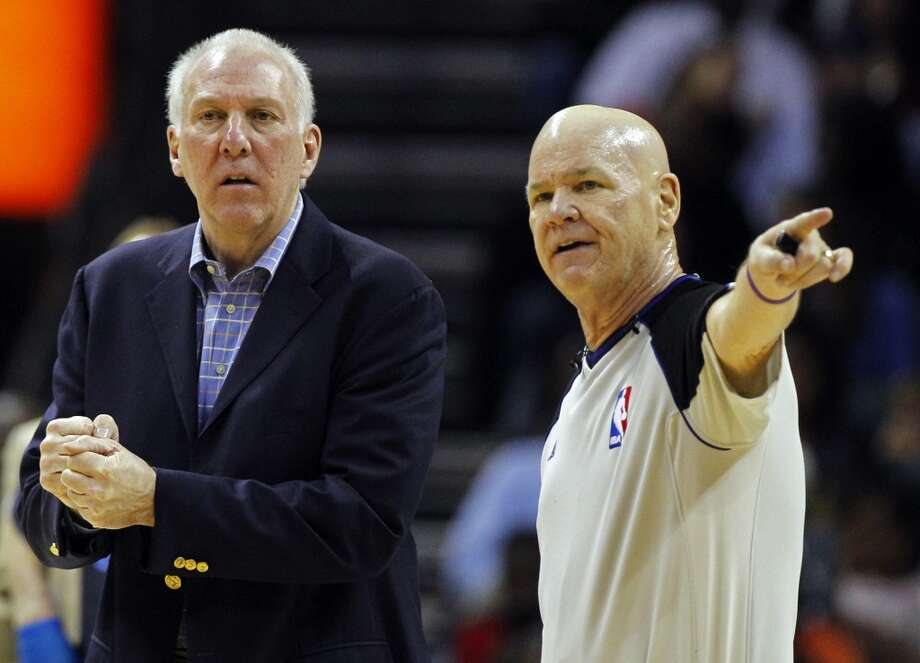 San Antonio Spurs head coach Gregg Popovich, left, talks with referee Joe Crawford, right, during the first half of an NBA basketball game against the Charlotte Bobcats in Charlotte, N.C., Saturday, Dec. 8, 2012. (AP Photo/Chuck Burton) (Associated Press)