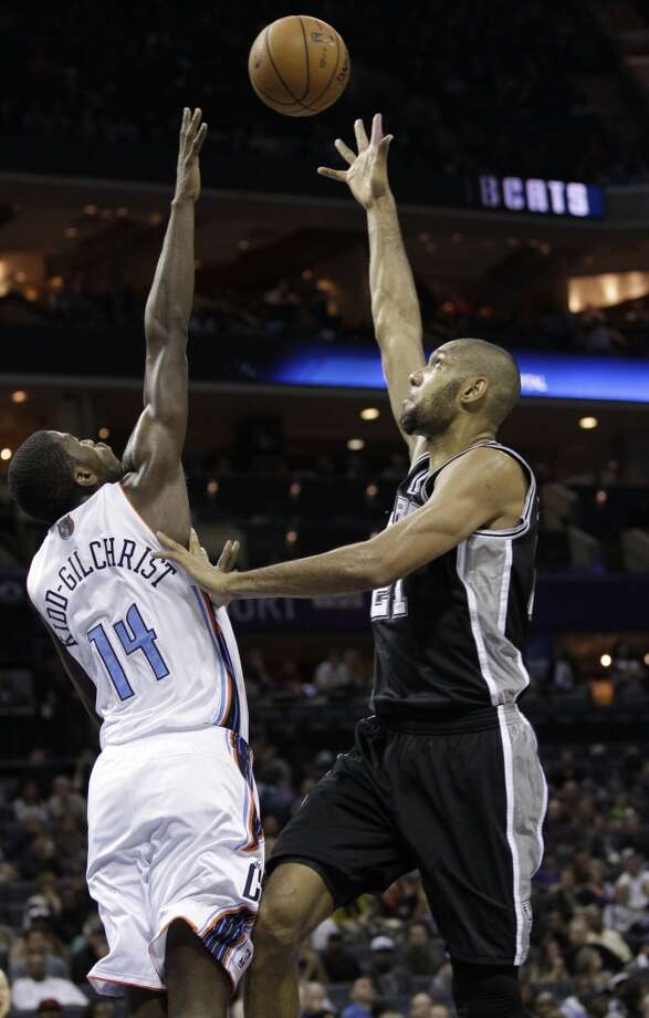 San Antonio Spurs' Tim Duncan, right, shoots over Charlotte Bobcats' Michael Kidd-Gilchrist, left, during the first half of an NBA basketball game in Charlotte, N.C., Saturday, Dec. 8, 2012. (AP Photo/Chuck Burton) (Associated Press)