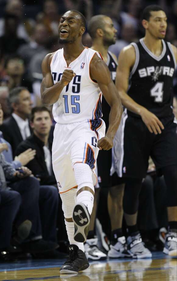 Charlotte Bobcats' Kemba Walker (15) reacts after making a basket against the San Antonio Spurs during the first half of an NBA basketball game in Charlotte, N.C., Saturday, Dec. 8, 2012. (AP Photo/Chuck Burton) (Associated Press)