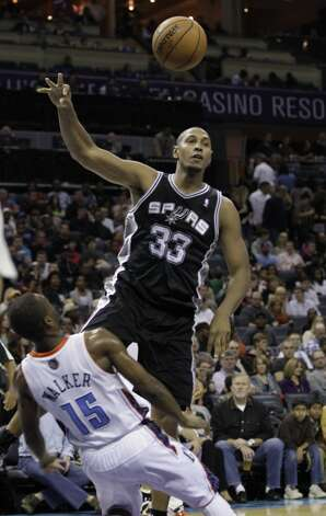 San Antonio Spurs' Boris Diaw (33) runs into Charlotte Bobcats' Kemba Walker (15) during the first half of an NBA basketball game in Charlotte, N.C., Saturday, Dec. 8, 2012. Walker was charged with a foul. (AP Photo/Chuck Burton) (Associated Press)
