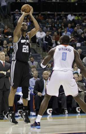 San Antonio Spurs' Tim Duncan (21) shoots over Charlotte Bobcats' Bismack Biyombo (0) during the first half of an NBA basketball game in Charlotte, N.C., Saturday, Dec. 8, 2012. (AP Photo/Chuck Burton) (Associated Press)