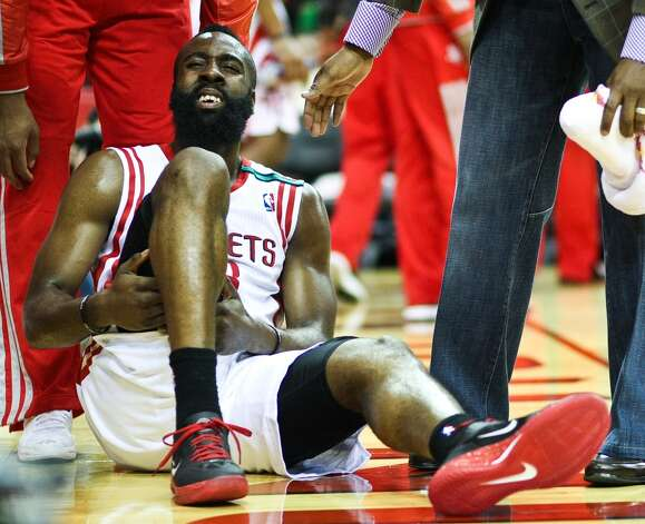James Harden grimaces after he hits the ground. (Nick de la Torre  / Houston Chronicle)
