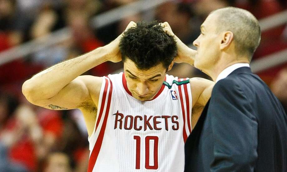 Rockets small forward Carlos Delfino pulls his hair after making a mistake during the fourth quarter. (Nick de la Torre  / Houston Chronicle)