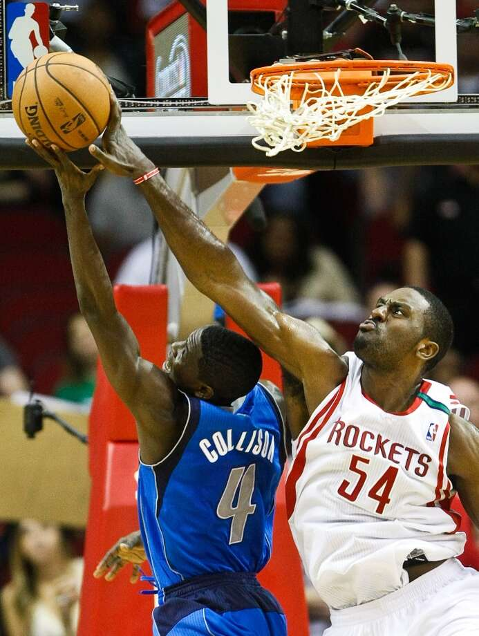 Mavericks point guard Darren Collison gets his shot blocked by Rockets power forward Patrick Patterson. (Nick de la Torre  / Houston Chronicle)