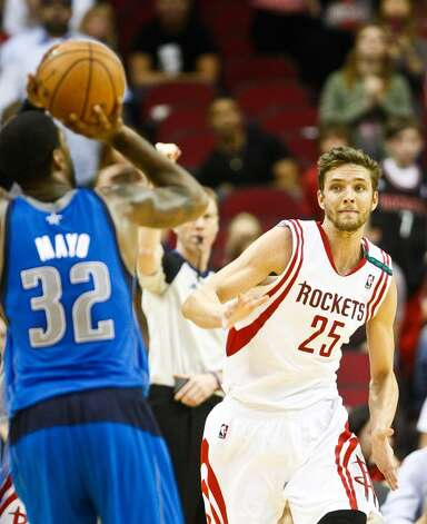 Rockets small forward Chandler Parsons runs in vein at a wide open Mavericks shooting guard O.J. Mayo. (Nick de la Torre  / Houston Chronicle)