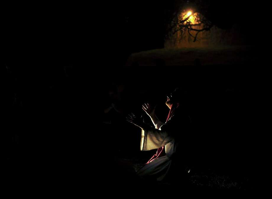 "Jesus Christ prays in the Garden of Gethsemane at the end of a narration of the birth and life of Jesus during ""Christmas City"" at Gateway Church, 6623 Five Palms Dr., on Thursday, Dec. 6, 2012. The event continues nightly through Sunday. Photo: Billy Calzada, San Antonio Express-News / SAN ANTONIO EXPRESS-NEWS"
