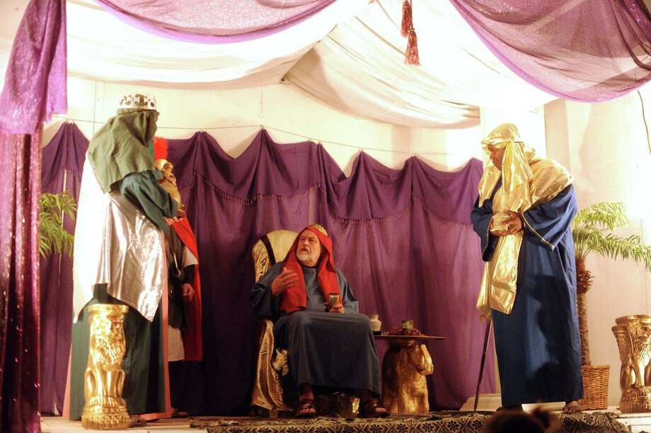 "King Herod, middle, listens to the wise men during a living replica of Bethlehem called ""Christmas City"" at Gateway Church, 6623 Five Palms Dr., on Thursday, Dec. 6, 2012. The event continues nightly through Sunday. Photo: Billy Calzada, San Antonio Express-News / SAN ANTONIO EXPRESS-NEWS"