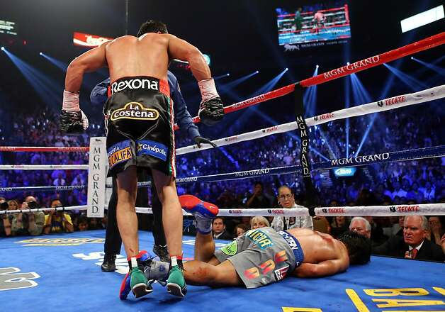 Manny Pacquiao is down for the count after a sixth-round right from Juan Manuel Marquez. Photo: Al Bello, Getty Images