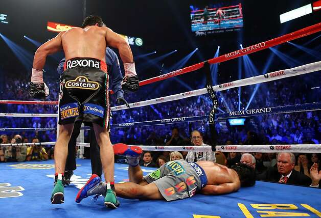 LAS VEGAS, NV - DECEMBER 08:  Manny Pacquiao lays face down on the mat after being knocked out in the sixth round by Juan Manuel Marquez during their welterweight bout at the MGM Grand Garden Arena on December 8, 2012 in Las Vegas, Nevada.  (Photo by Al Bello/Getty Images) Photo: Al Bello, Getty Images