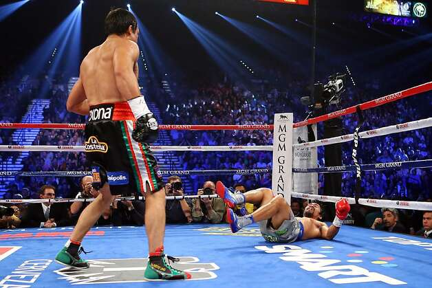 LAS VEGAS, NV - DECEMBER 08:  (L-R) Juan Manuel Marquez knocks down Manny Pacquiao in the third round during their welterweight bout at the MGM Grand Garden Arena on December 8, 2012 in Las Vegas, Nevada.  (Photo by Al Bello/Getty Images) Photo: Al Bello, Getty Images