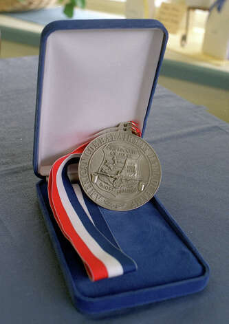 Retired Air Force Col. Ralph Parr received this medal when he was inducted into the American Combat Airmen's Hall of Fame. Photo: Express-News File Photo