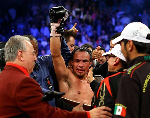 LAS VEGAS, NV - DECEMBER 08:  Juan Manuel Marquez celebrates after defeating Manny Pacquiao by a sixth round knockout in their welterweight bout at the MGM Grand Garden Arena on December 8, 2012 in Las Vegas, Nevada.  (Photo by Al Bello/Getty Images) Photo: Al Bello, Getty Images