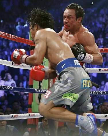 Juan Manuel Marquez, from Mexico, right, knocks out Manny Pacquiao, from the Philippines, in the sixth round of their WBO world welterweight  fight Saturday, Dec. 8, 2012, in Las Vegas. (AP Photo/Eric Jamison) Photo: Eric Jamison, Associated Press