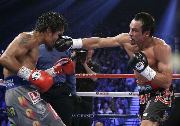 Juan Manuel Marquez, from Mexico, right, lands a right to the head of Manny Pacquiao, from the Philippines, during their WBO world welterweight  fight Saturday, Dec. 8, 2012, in Las Vegas. Marquez won by a knockout. (AP Photo/Julie Jacobson) Photo: Julie Jacobson, Associated Press