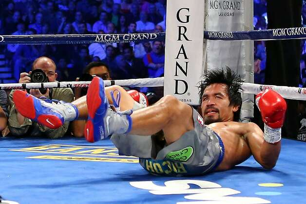 LAS VEGAS, NV - DECEMBER 08:  Manny Pacquiao is knocked down in the third round while taking on Juan Manuel Marquez during their welterweight bout at the MGM Grand Garden Arena on December 8, 2012 in Las Vegas, Nevada.  (Photo by Al Bello/Getty Images) Photo: Al Bello, Getty Images