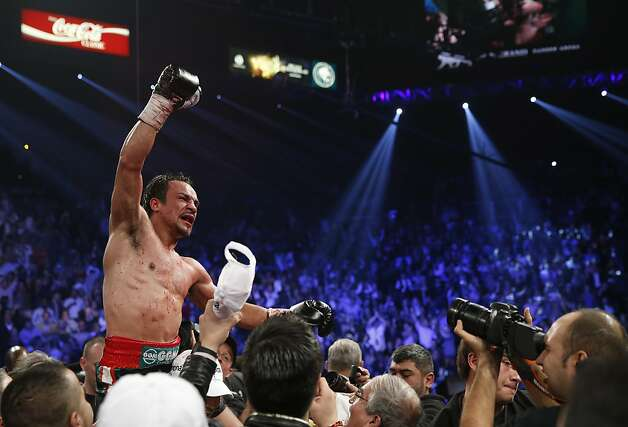 Juan Manuel Marquez, from Mexico, left, celebrates his win over Manny Pacquiao in their WBO world welterweight  fight Saturday, Dec. 8, 2012, in Las Vegas. (AP Photo/Eric Jamison) Photo: Eric Jamison, Associated Press