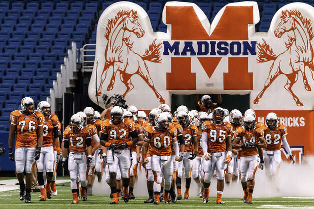 The Madison Mavericks take the field prior to their Class 5A Division I state quarterfinal game with O'Connor at the Alamodome on Dec. 8, 2012.  MARVIN PFEIFFER/ mpfeiffer@express-news.net Photo: MARVIN PFEIFFER, For The Express-News / Express-News 2012