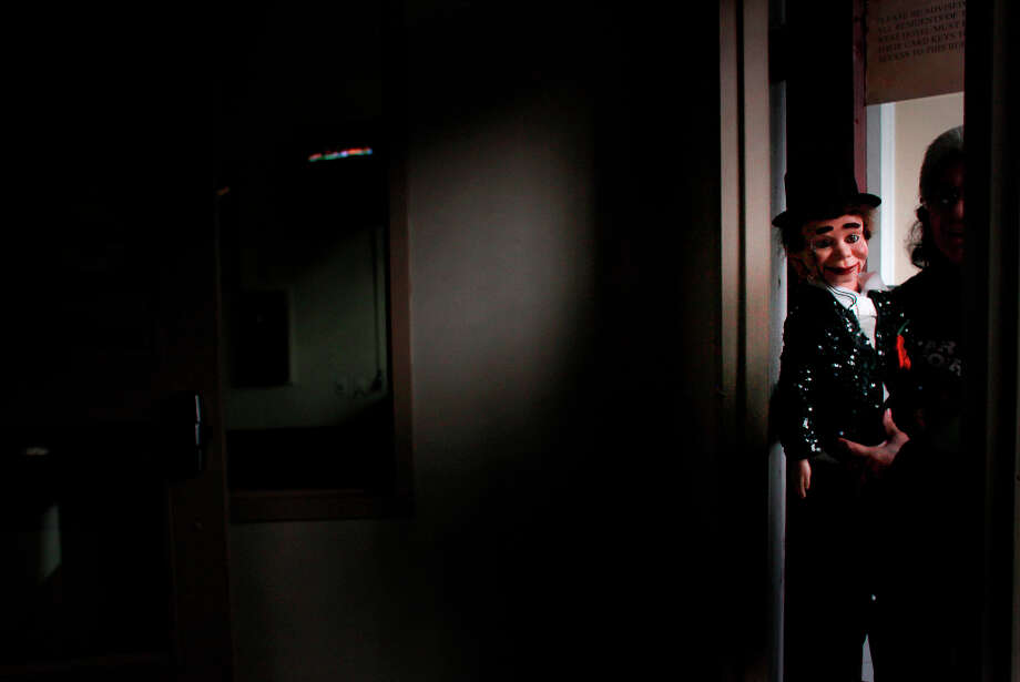 Indiana Munoz and her puppet Vincent Parker head home after visiting a friend at a residential hotel in the Tenderloin. Photo: Mike Kepka, The Chronicle / ONLINE_YES
