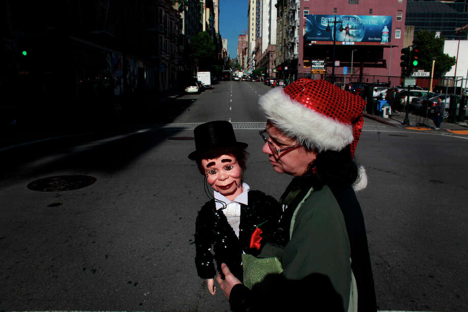 Indiana Munoz heads home with her puppet Vincent Parker in the Tenderlion. She says Vincent usually commands a lot of attention from people on the street. Photo: Mike Kepka, The Chronicle / ONLINE_YES