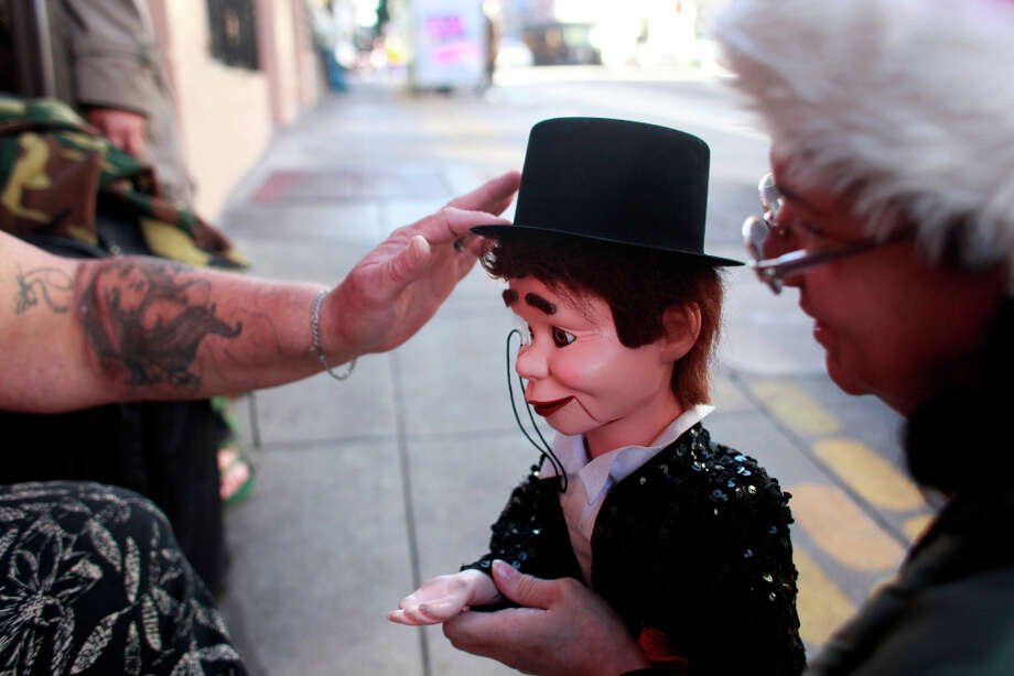 Richard Tank Fear says goodbye to his friend Vincent Parker in the Tenderloin. He's too smart to be a dummy, said Fear. Photo: Mike Kepka, The Chronicle / ONLINE_YES