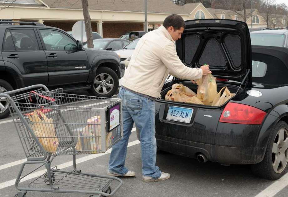 Umberto Torrielli, of Monroe, CT shopping at the Stop & Shop in Newtown, loads his car with groceries, in preparation for the big snow storm, on Saturday, Dec. 19, 2009. Photo: Jay Weir / The News-Times