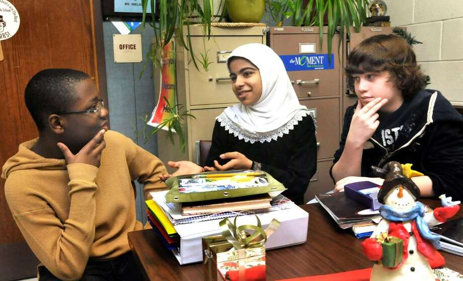 Broadview Middle School students talk about their holiday traditions, in Danbury, on Thursday, Dec.17,2009. From left are: Jordon Pierre, 13, in 8th grade, Anwar Abdulrehman, Evan Coco, both 12 and in 7th grade. Photo: Michael Duffy / The News-Times