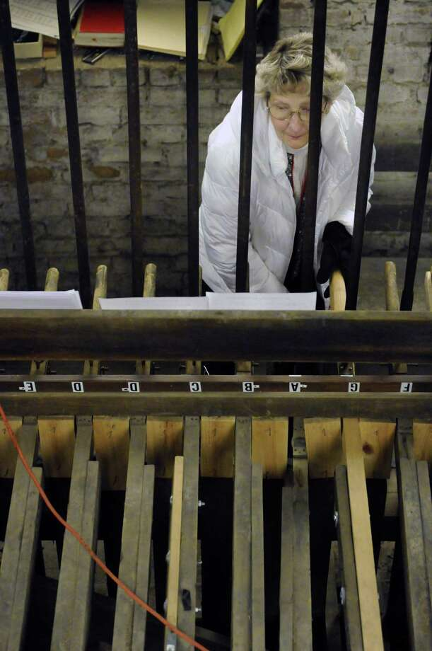 Gayle Walrath plays the restored 19th-century Meneely bells at the Cathedral of the Immaculate Conception in Albany, NY Saturday Dec. 8, 2012. (Michael P. Farrell/Times Union) Photo: Michael P. Farrell