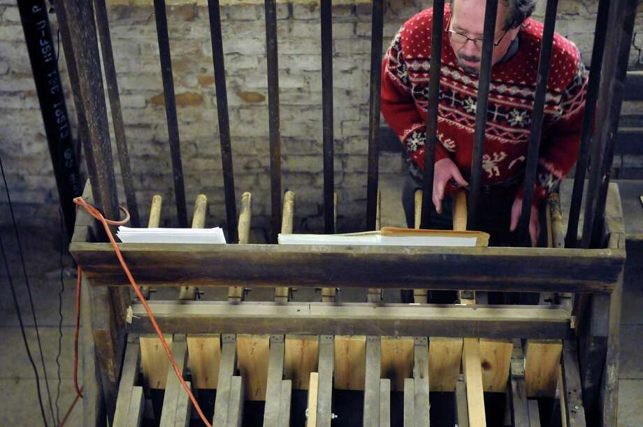 Charles Semowich, center, plays the restored 19th-century Meneely bells at the Cathedral of the Immaculate Conception in Albany, NY Saturday Dec. 8, 2012. (Michael P. Farrell/Times Union) Photo: Michael P. Farrell