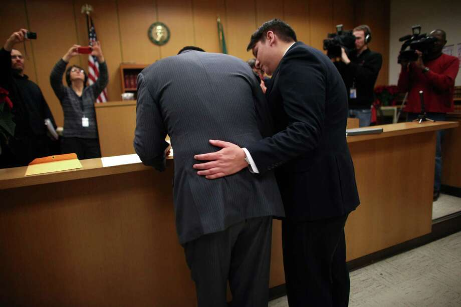 Jesse Page, left, and Brendan Taga, sign their marriage certificate just after midnight. Marriage ceremonies were held in the courtroom of Superior Court Judge Mary Yu beginning at 12:01 a.m. on Sunday, the first day same-sex couples in Washington State can legally be married. Photo: JOSHUA TRUJILLO / SEATTLEPI.COM