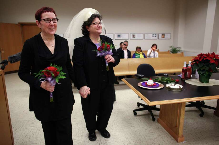 Cynthia Wallace, left, and Julie Fein prepare to be married after midnight at the King County Courthouse in Seattle. Marriage ceremonies were held in the courtroom of Superior Court Judge Mary Yu beginning at 12:01 a.m. on Sunday, the first day same-sex couples in Washington State can legally be married. Photo: JOSHUA TRUJILLO / SEATTLEPI.COM