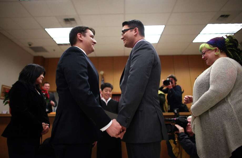 Brendan Taga, left, and Jesse Page exchange wedding vows. Photo: JOSHUA TRUJILLO / SEATTLEPI.COM