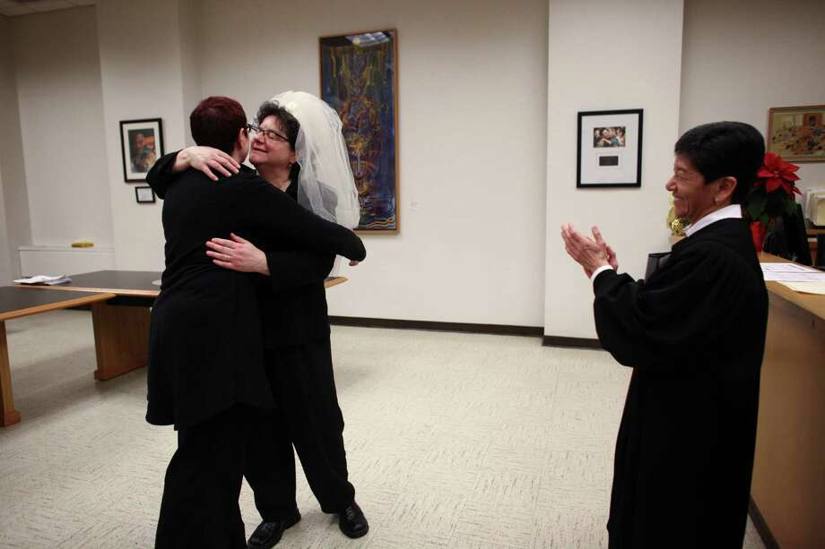 Cynthia Wallace, left, and Julie Fein celebrate their marriage at the King County Courthouse in Seattle. Photo: JOSHUA TRUJILLO / SEATTLEPI.COM