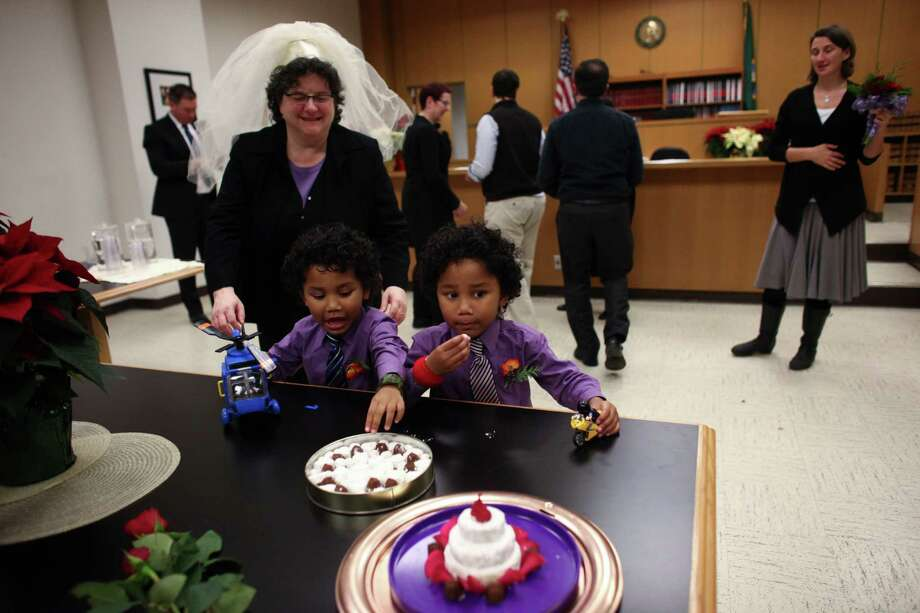Julie Fein checks on her sons Ari, left, and Rafi as the twins get into the wedding treats during Fein's wedding to Cynthia Wallace at the King County Courthouse in Seattle. Photo: JOSHUA TRUJILLO / SEATTLEPI.COM
