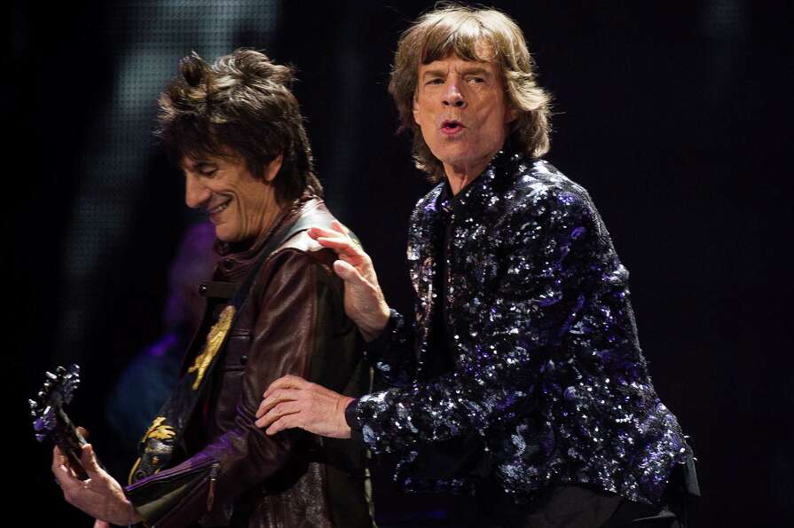 Ronnie Woods, left, and Mick Jagger of The Rolling Stones perform in concert on Saturday, Dec. 8, 20