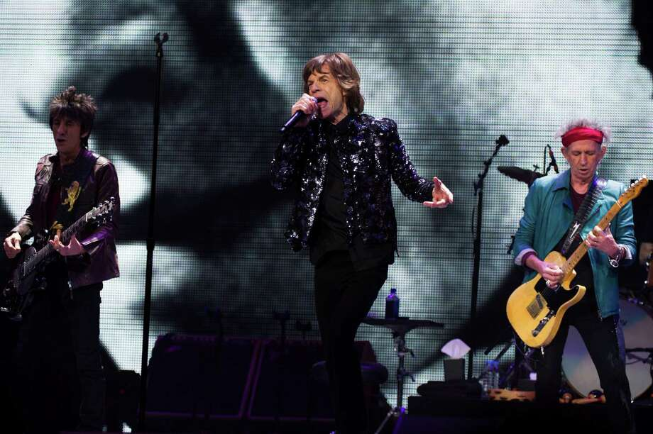 Ronnie Woods, from left, Mick Jagger and Keith Richards of The Rolling Stones perform in concert on Saturday, Dec. 8, 2012 in New York. Photo: Charles Sykes, Charles Sykes/Invision/AP / Invision